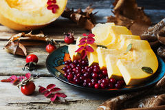 Ripe cranberries and pumpkin Royalty Free Stock Images