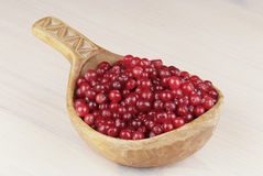 Ripe cranberry in wooden bowl Stock Photography