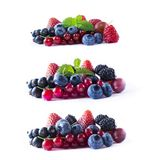 Ripe currants, blackberries, blueberries, strawberries and raspberries with mint leaves. Set of mix fruits and berries isolated on. White background. Fruits royalty free stock photo