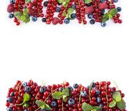 Ripe currants, raspberries, blueberries on white background. Berries at border of image with copy space for text. Background berri. Es. Various fresh summer Stock Images