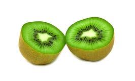 Ripe cut kiwi. Two halves of ripe juicy kiwi. Isolated over white Stock Photos