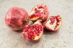 Ripe and cut pomegranates on Royalty Free Stock Image