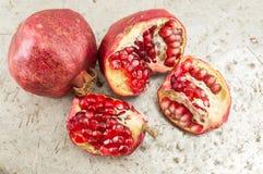Ripe and cut pomegranates on Stock Photos