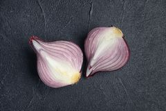 Ripe cut red onion on dark background. Top view Stock Photo