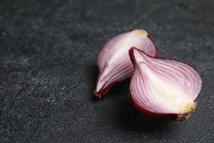 Ripe cut red onion. On table royalty free stock photos