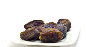 Ripe dates on the white Royalty Free Stock Photography
