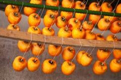 Ripe diospyros fruits Stock Images