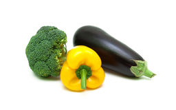 Ripe eggplant, yellow peppers and broccoli isolated on white bac Royalty Free Stock Photos