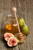 Ripe Fig Fruits with honey Stock Photo