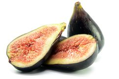 Ripe fig fruits. On the white background royalty free stock image