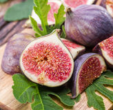 Ripe fig fruits on the wooden. Stock Photos
