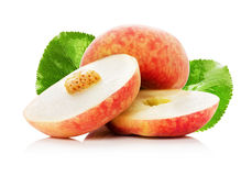 Ripe fig peach slice with leaves isolated on white background Stock Photos