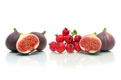 Ripe figs and apples on a white background royalty free stock image