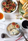 Ripe figs, blue cheese, baguette and coffee Stock Photography
