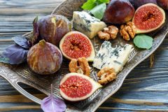 Ripe figs, blue cheese and walnuts. Royalty Free Stock Photos