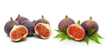 Ripe figs closeup on white background Stock Photos