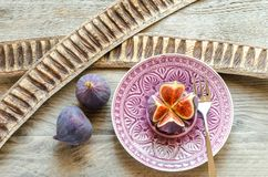 Ripe figs : cross section and whole fruits Royalty Free Stock Image