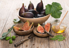 Ripe Figs In A Bowls And Honey Over Rustic Wooden Table Royalty Free Stock Image