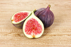 Ripe figs on wooden Stock Photos
