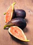 Ripe figs on wooden basis Royalty Free Stock Image