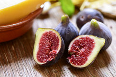 Ripe figs on a wooden surface Royalty Free Stock Images
