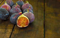 Ripe figs on wooden table Stock Images