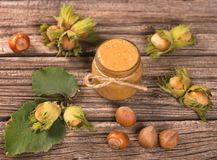 Fresh hazelnuts cream. Ripe filberts and hazelnuts cream over old wooden background Royalty Free Stock Images