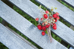 Ripe forest wild strawberry on old gray wooden planks Royalty Free Stock Image