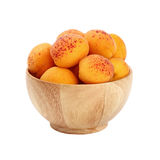 Ripe fresh apricots in wooden bowl over white Royalty Free Stock Image