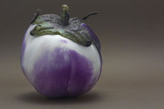 Ripe fresh aubergine isolated on brown background Stock Photos