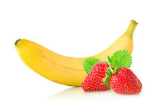 Ripe fresh banana and juicy strawberry with green leaf Stock Images