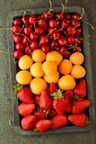 Ripe berries. Apricots, sweet cherry, strawberry stock photos