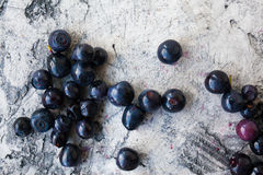 Ripe fresh blue berry. On scratched background Royalty Free Stock Photos