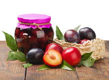 Ripe, fresh and canned plum. On white background Stock Photos
