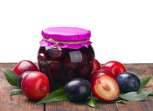Ripe, fresh and canned plum. Isolated on white background Stock Photos