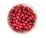 Ripe fresh cherries in a basket on a white isolated background. top view royalty free stock image