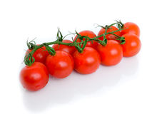 Ripe Fresh Cherry Tomatoes. On Branch Isolated on White Background Royalty Free Stock Photos