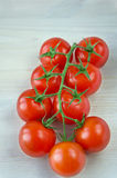 Ripe Fresh Cherry Tomatoes on white wooden table Stock Photography