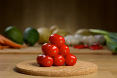 Ripe Fresh Cherry Tomatoes on a wooden table Stock Images