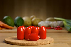 Ripe Fresh Cherry Tomatoes on a wooden table Royalty Free Stock Photography