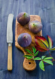 Ripe fresh Fig. Fresh, ripe fig on a board from an olive tree Royalty Free Stock Image