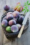 Ripe fresh Fig. Fresh, ripe fig in a basket Stock Photo