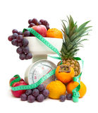 Ripe fresh fruit, kitchen scale and measuring tape isolated on a Stock Photos