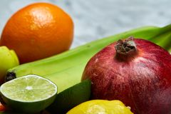 Ripe fresh fruits in a wooden plate on a light background, selective focus, close-up, top view Royalty Free Stock Images