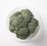 Ripe fresh green cabbage broccoli. Ripe fresh green cabbage broccoli on a white clean plate Stock Photography