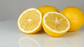 Ripe fresh juicy yellow lemon on white background rotate