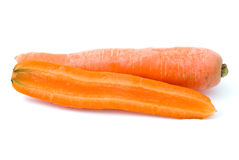Ripe fresh long carrot and half. Isolated on the white background Stock Photo