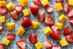 Ripe and fresh mango, dragon fruit and strawberries close up. Stock Photo