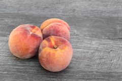 Fresh, organic peaches on wooden background. stock photos