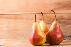 Ripe fresh pear on wood desk Stock Image